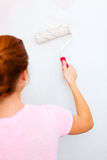 Young woman painting wall Stock Photos