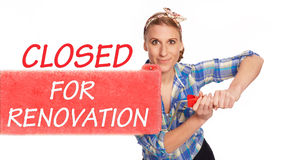 Young woman paints closed for Renovation Royalty Free Stock Photos