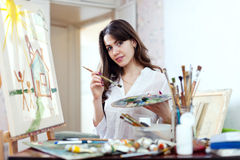 Young woman paints home of dreams Stock Photo