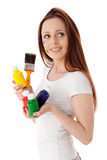 Young woman with paints and paintbrush. Stock Photo