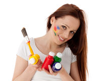 Young woman with paints and paintbrush. Royalty Free Stock Images