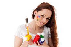 Young woman with paints and paintbrush. Royalty Free Stock Photos