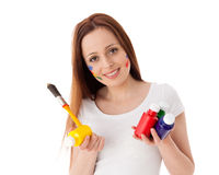 Young woman with paints and paintbrush. Stock Photos