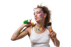 Young woman with  paints and paintbrushes. Stock Image