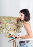 Young woman paints a picture Stock Photos