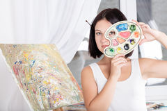 Young woman paints a picture Royalty Free Stock Image