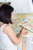 Young woman paints a picture Stock Photo