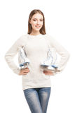 Young woman with pair of ice skates isolated Stock Photography