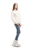 Young woman in pair of ice skates isolated Royalty Free Stock Photography