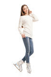 Young woman in pair of ice skates isolated Royalty Free Stock Images