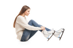 Young woman in pair of ice skates isolated Stock Image