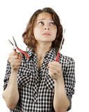 Young woman with a pair of pliers and a screwdriver Stock Image