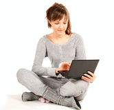 Young woman in pajamas with laptop Royalty Free Stock Photos