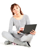 Young woman in pajamas with laptop Stock Images