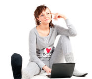 Young woman in pajamas with laptop Royalty Free Stock Images