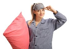 Young woman in pajamas with a pillow and a sleeping mask royalty free stock photo
