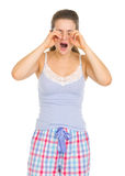 Young woman in pajamas rubbing eyes Royalty Free Stock Image
