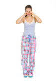 Young woman in pajamas rubbing eyes Stock Image