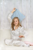 Young woman in pajamas Stock Image