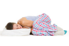 Young woman in pajamas sleeping on pillow Royalty Free Stock Image