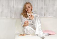 Young woman in pajamas Stock Photo