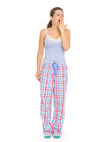 Young woman in pajamas yawing Royalty Free Stock Photos