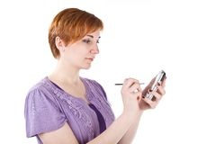 Young woman with palmtop Royalty Free Stock Photography