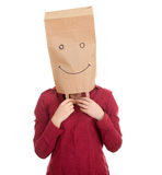 Young woman in paper bag on head Royalty Free Stock Image