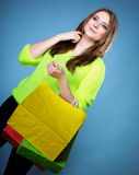 Young woman with paper multi coloured shopping bag Stock Photography