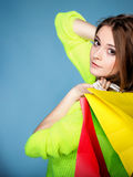 Young woman with paper multi coloured shopping bag Royalty Free Stock Photos