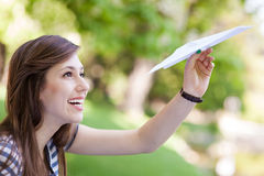 Young woman with paper plane Royalty Free Stock Photo