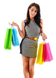 Young woman with paper shopping bags isolated on white.  Royalty Free Stock Images