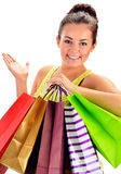 Young woman with paper shopping bags isolated on white Royalty Free Stock Image
