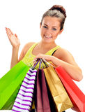 Young woman with paper shopping bags isolated on white Stock Image