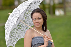 Young woman with parasol Royalty Free Stock Photos