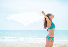 Young woman with parero rejoicing on beach Royalty Free Stock Photography
