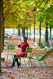 Young woman in Paris by fall royalty free stock images