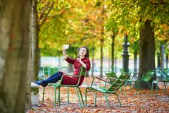 Young woman in Paris by fall stock photography