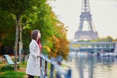 Young woman in Paris near the Eiffel tower royalty free stock photos