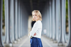 Young woman in Paris outdoors Stock Image