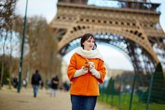 Young woman in Paris with take-away coffee Royalty Free Stock Image
