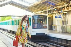 Young woman in Parisian underground. Beautiful young woman waiting for a train on the platform of Parisian underground Stock Images