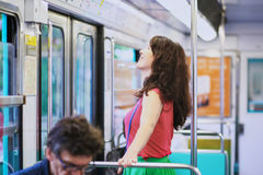Young woman in Parisian underground Stock Images