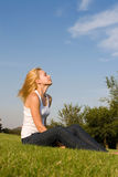 Young woman in the park Royalty Free Stock Images