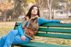 Young woman in park Royalty Free Stock Photography