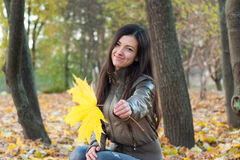 Young woman in park Royalty Free Stock Image