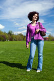 Young woman in a park Stock Images