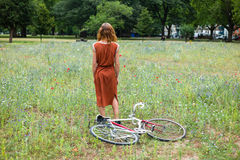 Young woman in park with bicycle Royalty Free Stock Photography