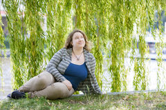 Young woman in park Stock Images
