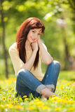 Young woman in the park. With flowers Stock Photos
